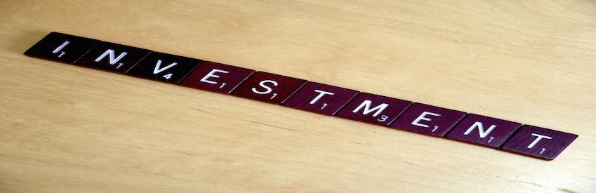 Investment tiles game scrabble