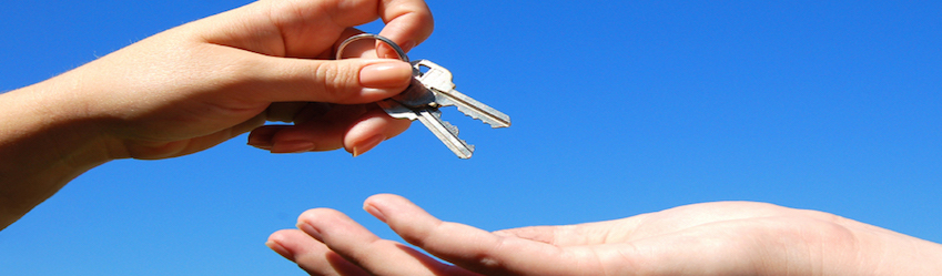 Handing keys from one hand to the next. Magum York Condo
